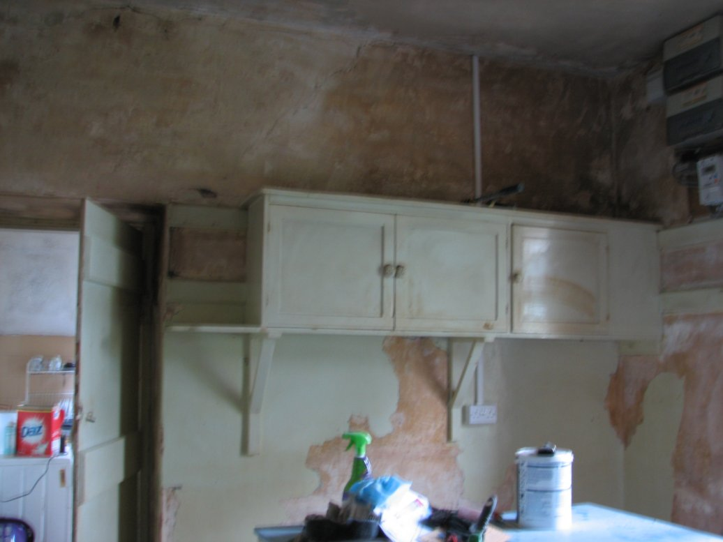 The cupboards along the wall shared with the scullery at the back of the house