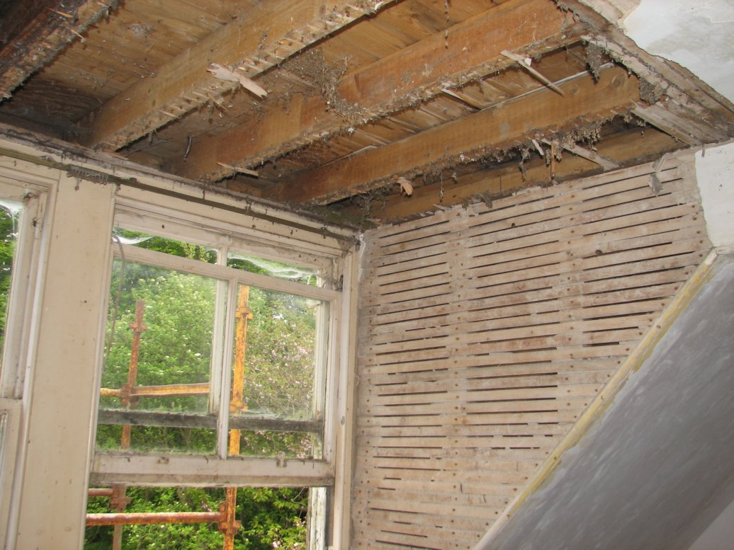 We started stripping off the lath and plaster in the dormer room to the north of the house and discovered...