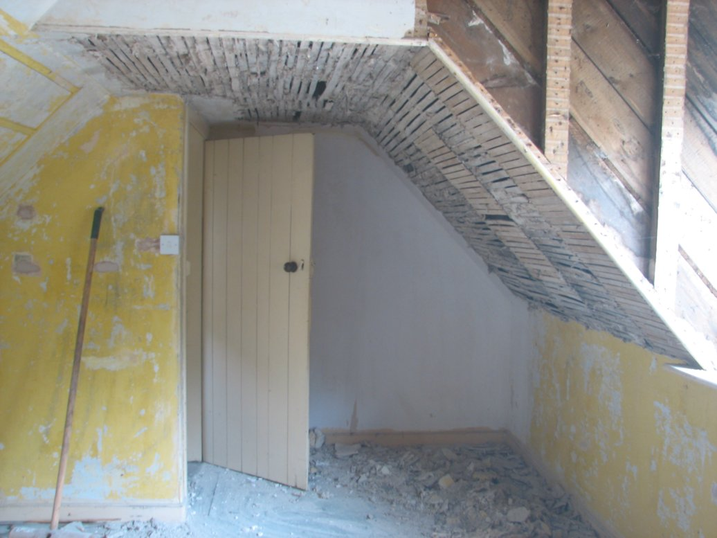 The knocking out of the lath and plaster in the dormer room really got started in June
