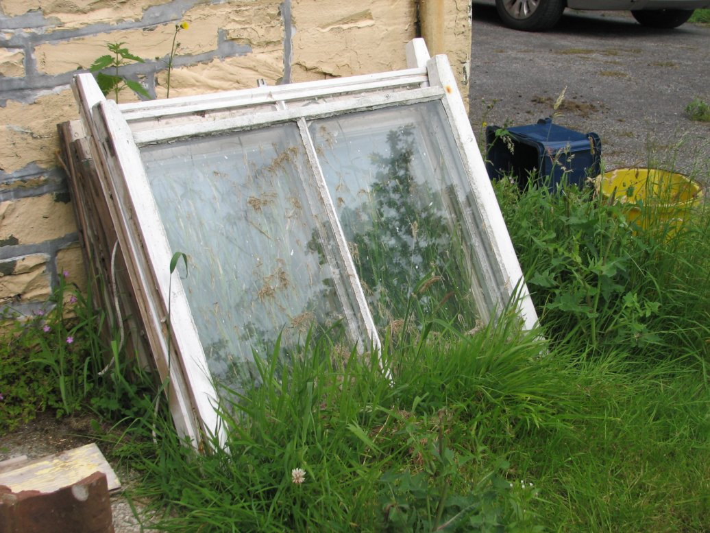 We're not quite sure what we'll do with the old glass from the windows that were replaced, but they may well become cold frames for next year's growing season