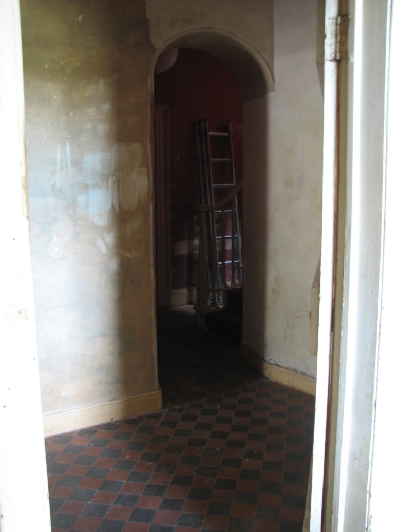 Formerly a black tarry colour, this is the view from the kitchen doorway into the hallway and back stairs